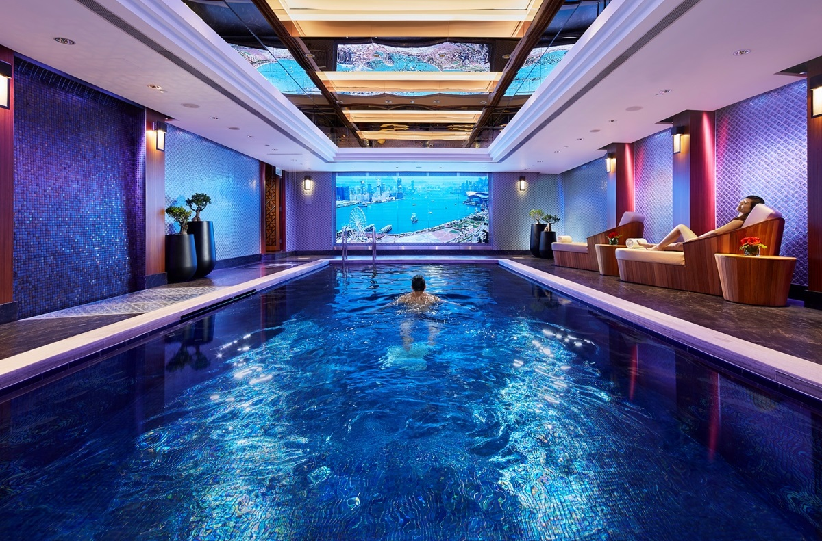 Mandarin Oriental Hong Kong swimming pool with swimmer